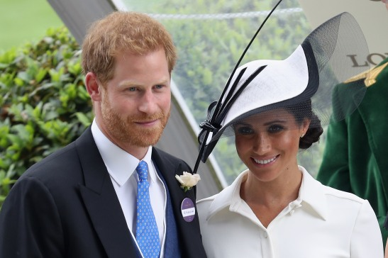 ASCOT, ENGLAND - JUNE 19: Meghan, Duchess of Sussex and Prince Harry, Duke of Sussex attend the prize ceremony of Royal Ascot Day 1 at Ascot Racecourse on June 19, 2018 in Ascot, United Kingdom. (Photo by Chris Jackson/Getty Images)