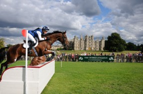 DE0XDW Kristina Cook riding De Novo News during the Cross Country Phase at the 2013 Land Rover Burghley Horse Trials, Stamford, UK.