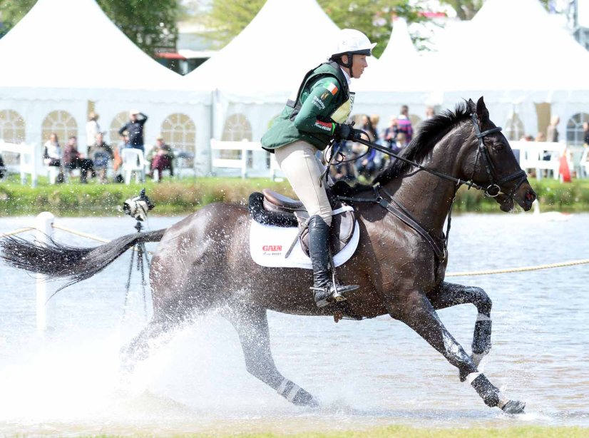 Aiofe Clark and Vaguely North gallop through the Lower Lake and lie 11th after cross country at The Mitsubishi Motors Badminton Horse Trials, 8-5-15